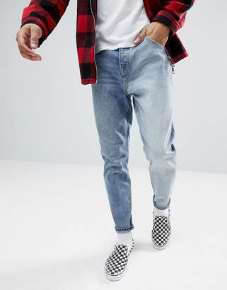 Asos DESIGN Tapered Jeans In Two Tone Mid Wash