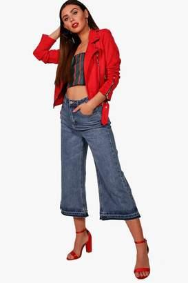 boohoo Petite Mid Rise Hem Detail Wide Leg Jeans