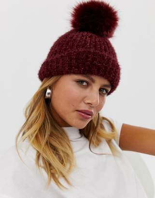 New Look fluffy faux fur pom pom bobble hat in dark burgundy