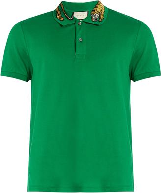 GUCCI Tiger embroidered-collar piqué polo shirt $670 thestylecure.com