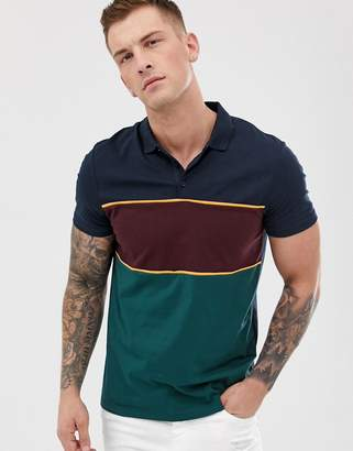 Asos Design DESIGN polo shirt with retro color block in navy