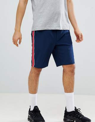 Asos DESIGN slim shorts with elasticated waistband in navy with red side stripe