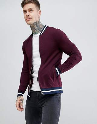 Asos DESIGN jersey muscle bomber jacket in burgundy with striped tipping