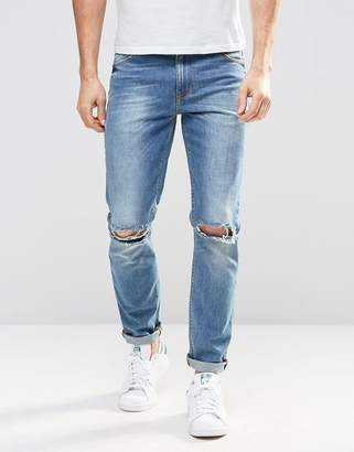 Asos DESIGN Skinny Jeans In Mid Wash With Knee Rips