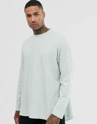 Asos Design DESIGN oversized long sleeve t-shirt with extreme side splits in pale green