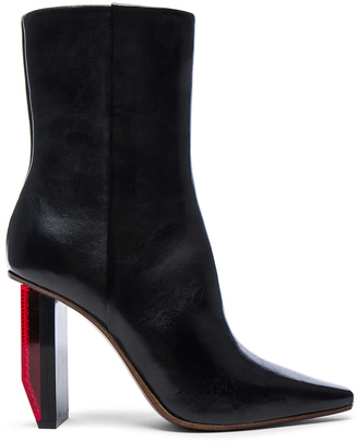 VETEMENTS Reflector Leather Ankle Boots $1,710 thestylecure.com