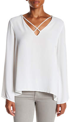 Lush Crisscross Bell Sleeve Blouse $45 thestylecure.com