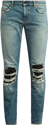 SAINT LAURENT Distressed leather-insert skinny jeans $990 thestylecure.com