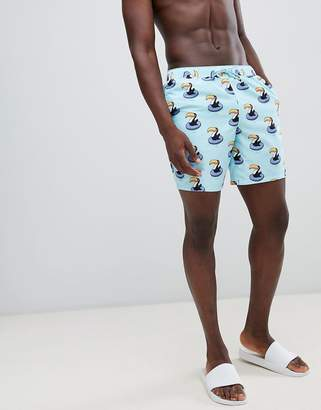 Asos Design DESIGN swim shorts with toucan print in mid length