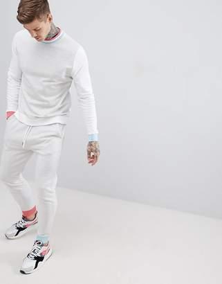 Asos DESIGN tracksuit sweatshirt/skinny joggers in gray marl color block