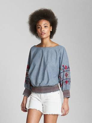 Gap Embroidered Long Sleeve Smocked Top in Chambray