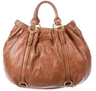 Miu Miu Buckle-Accented Leather Hobo Brown Buckle-Accented Leather Hobo