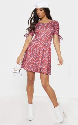 156f22dfb0 PrettyLittleThing Red Floral Print Ruched Sleeve Skater Dress