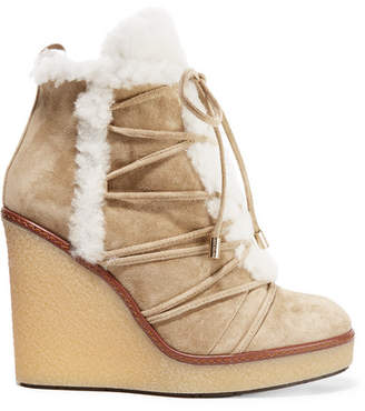 Moncler - Shearling-trimmed Suede Wedge Boots - Sand $740 thestylecure.com