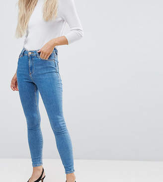Asos DESIGN Petite Ridley high waist skinny jeans in light wash