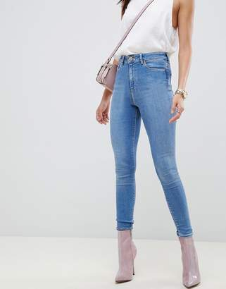 Asos DESIGN Ridley high waist skinny jeans in lavender blue tone wash