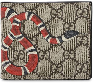62b84689c0ee Gucci Snake Printed Coated Canvas Wallet