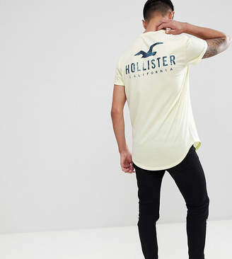 Hollister front and back logo print t-shirt curved hem in yellow Exclusive at ASOS