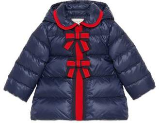 Gucci Baby quilted nylon jacket with bows