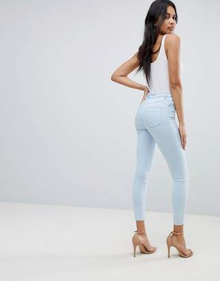 Asos DESIGN Ridley high waist skinny jeans in philomena ice light stone wash