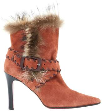 Christian Louboutin Orange Suede Ankle boots