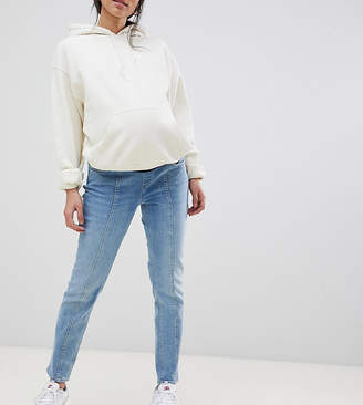Asos DESIGN Maternity kimmi boyfriend jeans in mid wash blue with vertical seam detail with over bump waistband
