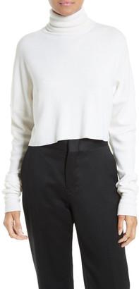 tibi Split Silk Back Merino Wool Turtleneck Pullover $495 thestylecure.com