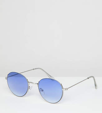 Asos DESIGN metal round sunglasses in silver with blue fade lens