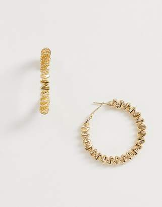 South Beach criss cross gold hoop earrings