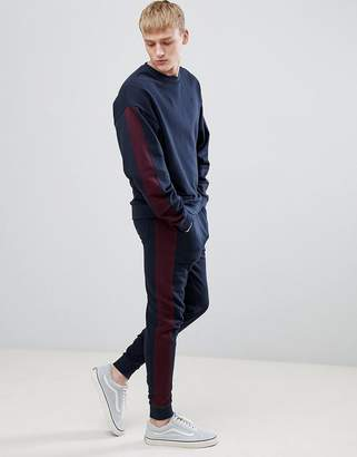 Asos DESIGN tracksuit oversized sweatshirt/skinny joggers with side stripe in navy and burgundy
