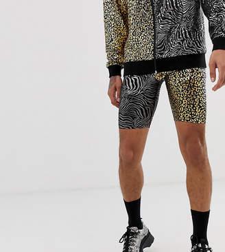 Reclaimed Vintage festival spliced jersey shorts in metallic animal