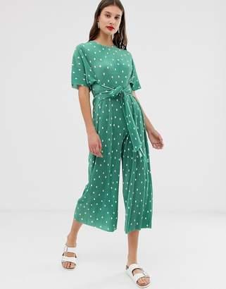 Asos Design DESIGN plisse tie front jumpsuit in spot print