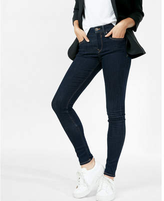 Express solid dark mid rise jean legging $79.90 thestylecure.com