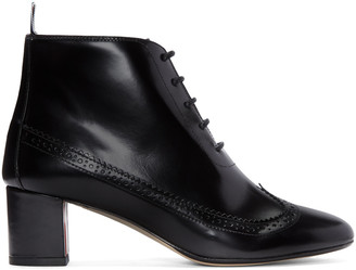Thom Browne Black Longwing Boots $1,080 thestylecure.com