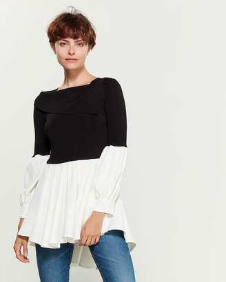 Gracia Black & White Long Sleeve Ruffle Bottom Top