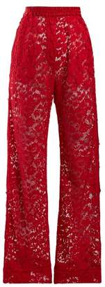 Dolce & Gabbana Flared Chantilly Lace Trousers - Womens - Red