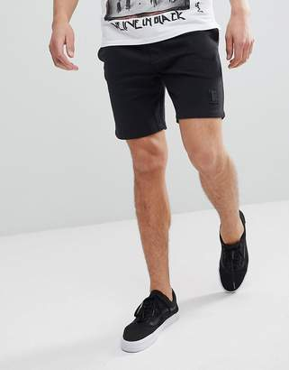 Religion Jersey Shorts In Black With Metal Badge