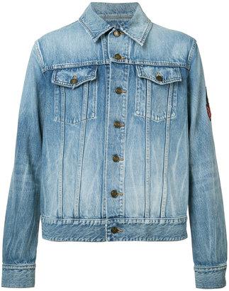 Saint Laurent patch detail denim jacket $1,250 thestylecure.com
