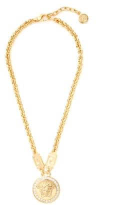 VERSACE Crystal-embellished Medusa necklace $495 thestylecure.com