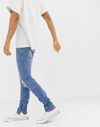 Religion Skinny Fit Jeans With Ripped Knee And Zip Hem