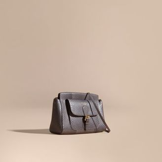 Burberry The Saddle Clutch in Python $2,495 thestylecure.com