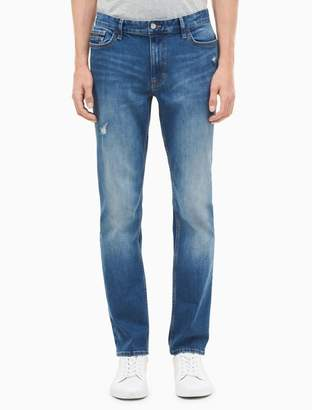 Calvin Klein slim straight isolation blue distressed jeans