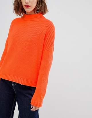 Asos Design DESIGN neon sweater with stitch sleeve detail