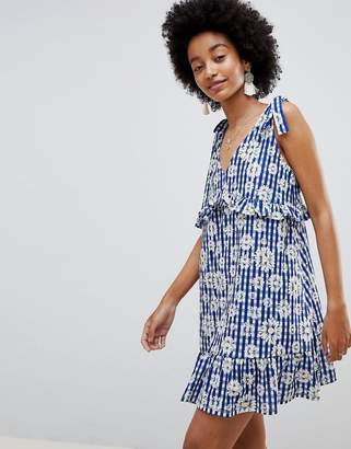 Asos DESIGN Tie Strap Sundress With Pep Hem In Floral Gingham