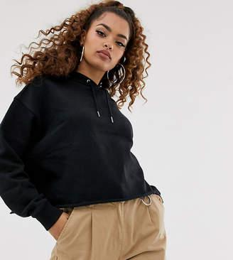 Asos DESIGN Petite cropped boxy hoodie in black
