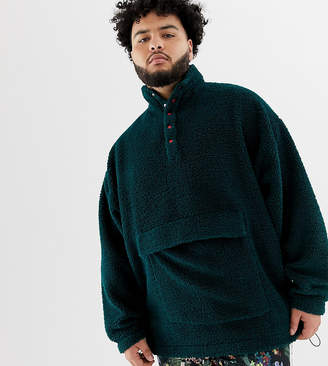Asos DESIGN plus oversized sweatshirt in borg with popper neck in green