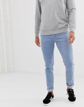 Asos DESIGN skinny jeans in flat light wash