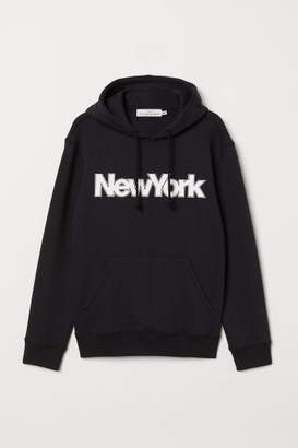 H&M Hooded Sweatshirt with Motif - Black