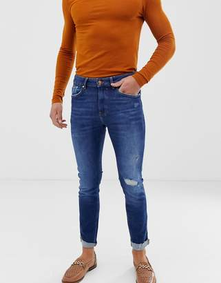 Bershka Join Life skinny jeans in mid blue with knee rip and abrasions