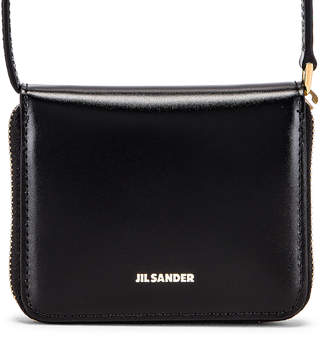 Jil Sander Hook Zip Wallet Crossbody Bag in Black | FWRD